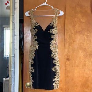 size 4 black and gold jovani dress